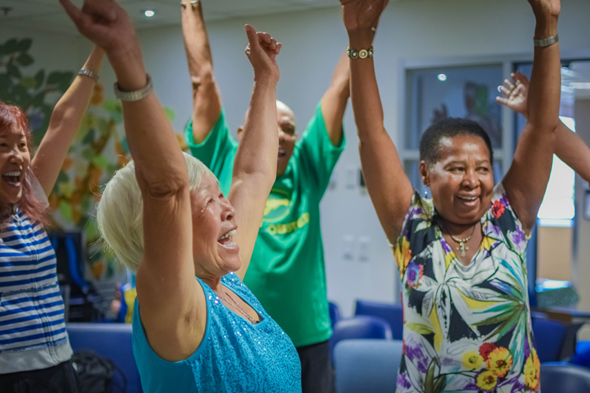 Seniors' Program Participants having fun at laughing yoga